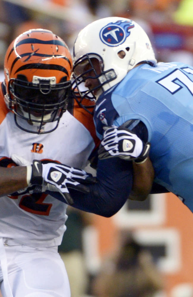 In this Aug. 17, 2013, file photo, Cincinnati Bengals outside linebacker James Harrison, left, pushes against Tennessee Titans tackle Michael Roos (71) in the first half of an NFL preseason football game in Cincinnati. Harrison first met Pittsburgh Steelers' Marcus Gilbert at the Steelers' training camp in 2011, but the two will play against each other Monday, Sept. 16, 2013