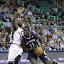 New Orleans Pelicans' Jrue Holiday (11) drives as Utah Jazz's John Lucas III (5) defends during the first quarter of an NBA basketball game Wednesday, Nov. 13, 2013, in Salt Lake City The Associated Press