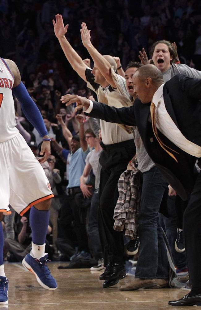 FILE- In this April 8, 2012, file photo, New York Knicks' Carmelo Anthony and fans react after Anthony scored a 3-point basket in the closing seconds of overtime in an NBA basketball game against the Chicago Bulls at Madison Square Garden in New York.  Two people with knowledge of the plans say the 2015 NBA All-Star weekend will be split between two New York arenas, with Madison Square Garden to host the game. Barclays Center in Brooklyn will host the Saturday skills events, the people confirmed to The Associated Press on condition of anonymity Tuesday, Sept. 24, 2013, because the plans were to be announced at a press conference Wednesday