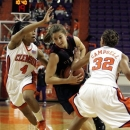 FILE- In this Jan. 14, 2010 file photo, Florida State's Leonor Rodriguez (10) gets fouled as she drives past Clemson's Christy Brown (4) and Morganne Campbell (32) during the first half of their women's NCAA college basketball game in Clemson, S.C. After an unremarkable first three seasons at a school far away from her home in Spain, the 21-year-old sharpshooter has become the driving force in the high-scoring Seminoles turnaround from its first loosing season in a decade. (AP Photo/Mary Ann Chastain, File)
