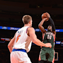 NEW YORK, NY - OCTOBER 20: O.J. Mayo #00 of the Milwaukee Bucks takes a shot against the New York Knicks on October 20, 2014 at Madison Square Garden in New York City, NY. (Photo by Jesse D. Garrabrant/NBAE via Getty Images)