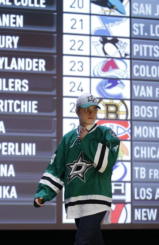 Julius Honka walks off the stage after being chosen 14th overall by the Dallas Stars during the first round of the NHL hockey draft, Friday, June 27, 2014, in Philadelphia