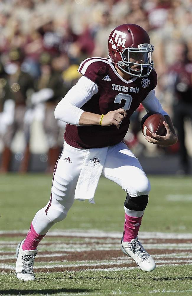 Texas A&M quarterback Johnny Manziel runs with the ball in the second quarter against Auburn during an NCAA college football game Saturday, Oct. 19, 2013, in College Station, Texas