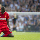 Liverpool's Mario Balotelli reacts after missing a chance to score against Tottenham Hotspur, during their English Premier League soccer match at White Hart Lane, London, Sunday, Aug. 31, 2014