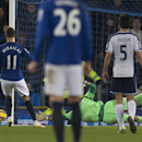 Everton's Kevin Mirallas, left, misses a penalty as West Bromwich Albion's goalkeeper Ben Foster dives in an attempt to save it during the English Premier League soccer match between Everton and West Bromwich Albion at Goodison Park Stadium, Liverpool, En
