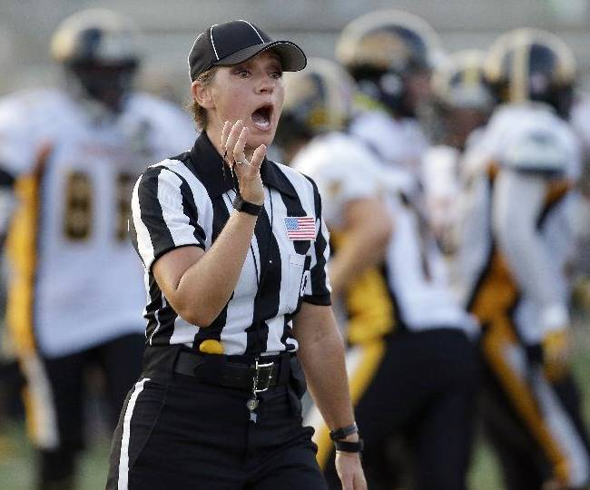 Cat Conti earns her stripes as football official