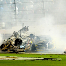 Brad Keselowski, right, crashes into Austin Dillon, left, after a multi-car wreck on the final lap of the NASCAR Sprint Cup series auto race at Daytona International Speedway, Monday, July 6, 2015, in Daytona Beach, Fla. (AP Photo/Rob Sweeten)