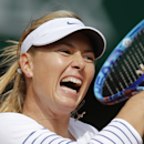 Russia's Maria Sharapova returns in the first round match of the French Open tennis tournament against Estonia's Kaia Kanepi at the Roland Garros stadium, in Paris, France, Monday, May 25, 2015. (AP Photo/Christophe Ena)