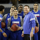 Kansas head coach Bill Self smiles with his players during practice for a regional semifinal game in the NCAA college basketball tournament, Thursday, March 28, 2013, in Arlington, Texas. Kansas faces Michigan on Friday. (AP Photo/David J. Phillip)