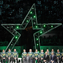 Former Dallas Stars player Mike Modano shares the stage with his former teammates from the Stanley Cup-winning season as he makes remarks, as the Stars retire his No. 9 jersey Saturday, March 8, 2014, before the NHL hockey team's game against the Minnesot