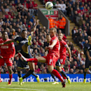 Liverpool's Rickie Lambert, center, is thwarted by Southampton's Nathaniel Clyne, center left, during their English Premier League soccer match at Anfield Stadium, Liverpool, England, Sunday Aug. 17, 2014