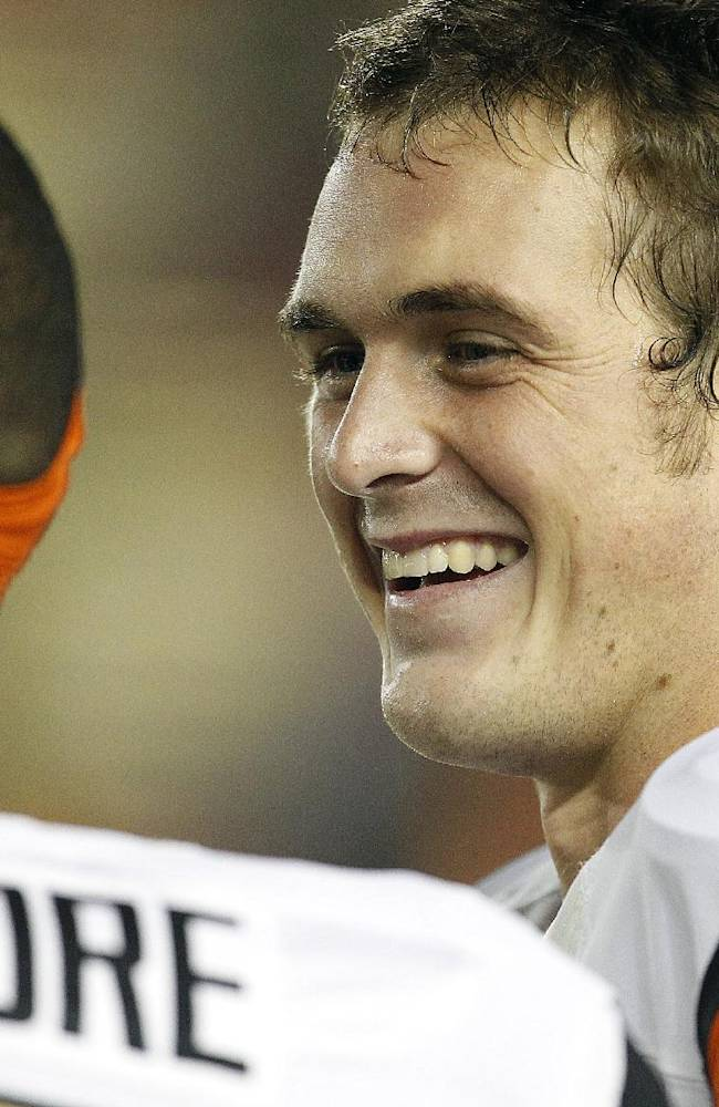 Oregon State quarterback Sean Mannion (4) smiles as he talks with  wide receiver Malik Gilmore (18) on the sidelines during the second half against California in a NCAA college football game in Berkeley, Calif., Saturday, Oct. 19, 2013. Oregon State won 49-17