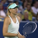 Maria Sharapova, from Russia, reacts while losing in an upset to Sloane Stephens, from the United States, in a match at the Western & Southern Open tennis tournament, Tuesday, August 13, 2013, in Mason, Ohio. (AP Photo/Michael E. Keating)