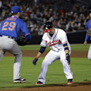 Atlanta Braves' Ramiro Pena, center, gets caught in a pickle between New York Mets first baseman Ike Davis, left, and shortstop Ruben Tejada, in the sixth inning of a baseball game, Thursday, April 10, 2014, in Atlanta The Associated Press