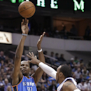 Oklahoma City Thunder forward Kevin Durant (35) shoots against Dallas Mavericks forward Shawn Marion (0) during the first half of an NBA basketball game Tuesday, March 25, 2014, in Dallas The Associated Press