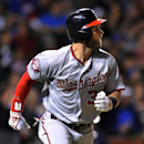Washington Nationals' Bryce Harper watches his solo home run during the sixth inning of a baseball game against the Chicago Cubs in Chicago, Wednesday, May 27, 2015. (AP Photo/Paul Beaty)