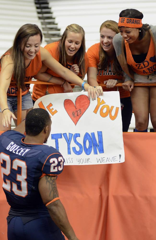 Adoring female fans of Syracuse University running back, Prince-Tyson Gulley, greet Gulley after Syracuse defeated Tulane 52-17 in an NCAA college football game at the Carrier Dome in Syracuse, N.Y., Saturday, Sept. 21, 2013