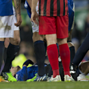 Everton's Kevin Mirallas receives treatment on the pitch before being carried off injured during the English Premier League soccer match between Everton and Queens Park Rangers at Goodison Park Stadium, Liverpool, England, Monday Dec. 15, 2014