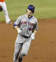 New York Mets' Jason Bay prepares to round third base after hitting a grand slam against the Miami Marlins in the first inning of a baseball game in Miami, Sunday, Sept. 2, 2012. (AP Photo/Alan Diaz)