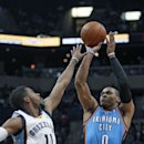 Oklahoma City Thunder's Russell Westbrook (0) shoots over Memphis Grizzlies' Mike Conley (11) in the first half of an NBA basketball game in Memphis, Tenn., Wednesday, Dec. 11, 2013. The Thunder defeated the Grizzlies 116-100 The Associated Press