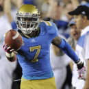 UCLA defensive back Tevin McDonald celebrates after his second interception during the second half of an NCAA college football game against California, Saturday, Oct. 29, 2011, in Pasadena, Calif. UCLA won 31-14. (AP Photo/Gus Ruelas)