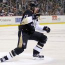 Pittsburgh Penguins' Evgeni Malkin celebrates his goal during the second period of an NHL hockey game against the New Jersey Devils in Pittsburgh, Tuesday, Oct. 28, 2014 The Associated Press