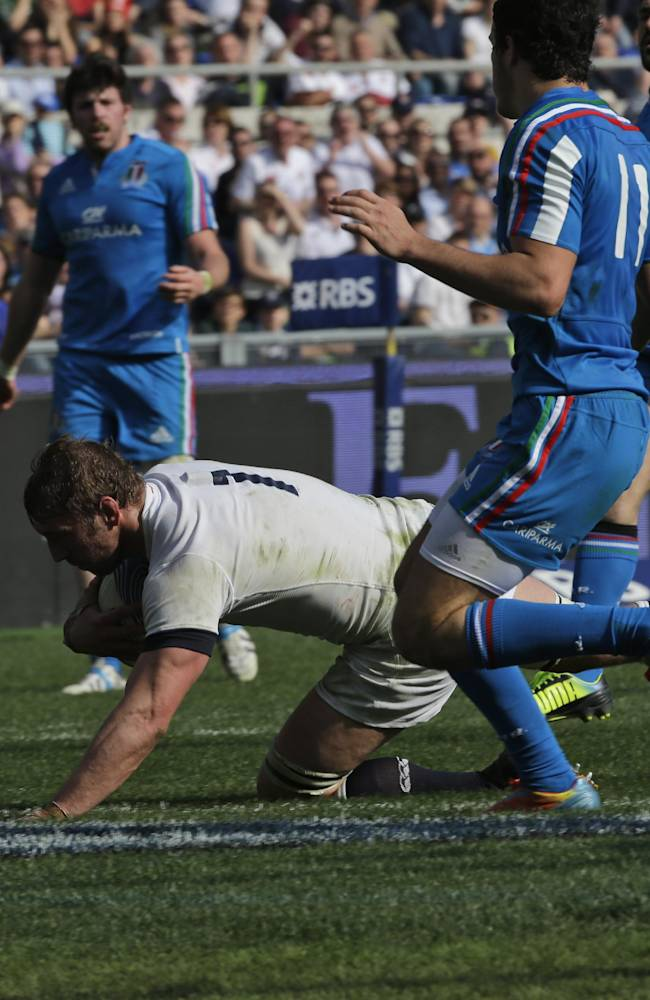 England captain Chris Robshaw, left, scores a try past Italy's Leonardo Sarto during a Six Nations international rugby union match between Italy and England, in Rome, Saturday, March 15, 2014. England won 52-11