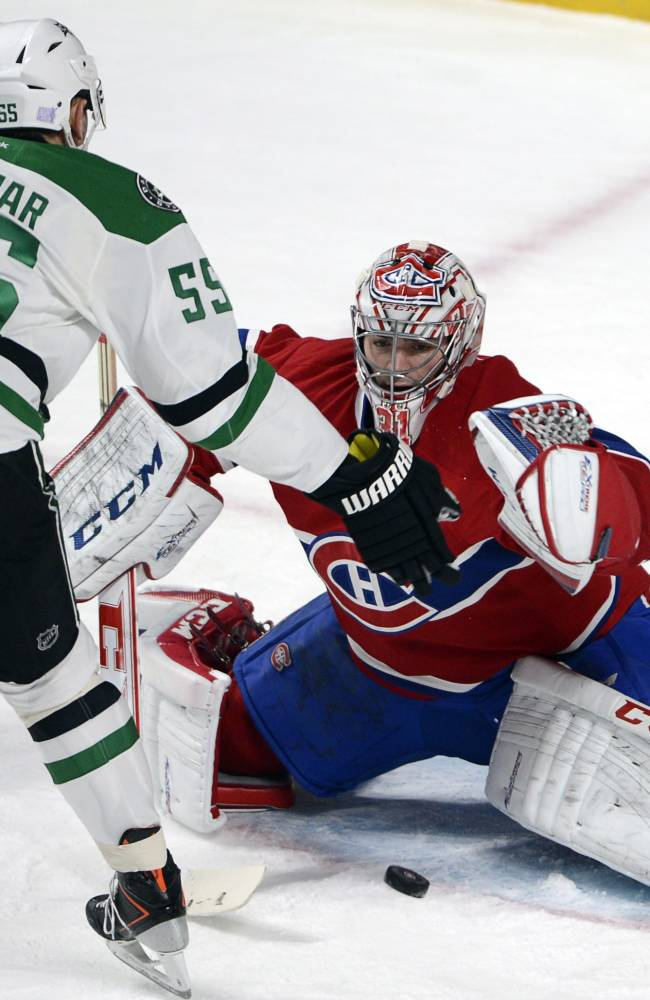 Montreal Canadiens goalie Carey Price (31) stops Dallas Stars defenseman Sergei Gonchar (55) during the third period of an NHL hockey game Tuesday, Oct. 29, 2013, in Montreal. The Canadiens won 2-1