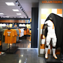 Vol Shop employee Thomas Shelton removes a cover from a mannequin with the new Nike football uniform inside Neyland Stadium, Wednesday, July 1, 2015. Nike took over as Tennessee's main apparel provider Wednesday as part of an eight-year contract worth about $35 million in money and gear. (Amy Smotherman Burgess/Knoxville News Sentinel via AP)