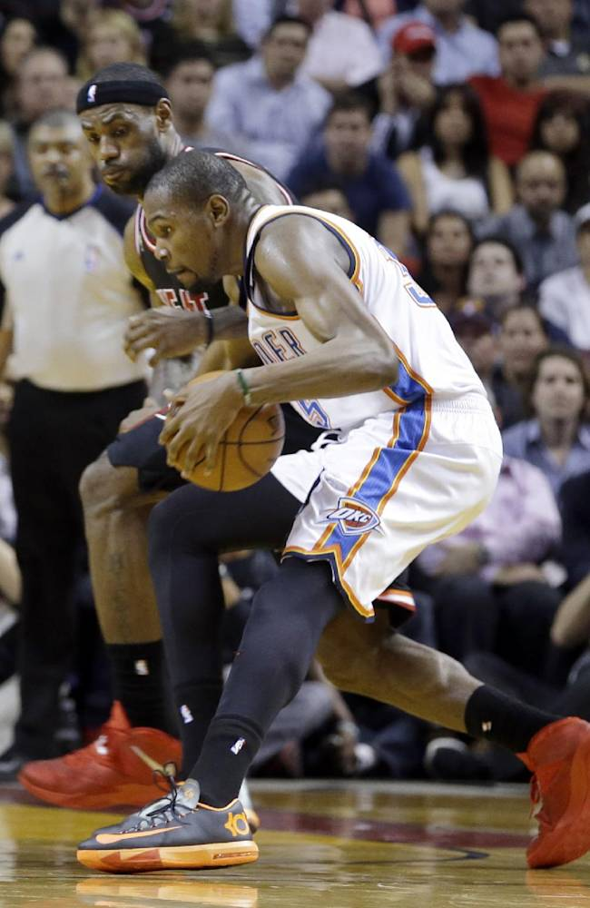 Oklahoma City Thunder small forward Kevin Durant (35) drives as Miami Heat small forward LeBron James (6) defends during the second period of an NBA basketball game in Miami, Wednesday, Jan. 29, 2014. (AP PhotoAlan Diaz)