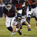 Baltimore Ravens tight end Dallas Clark (87) makes a pass reception against Chicago Bears safety Chris Conte (47) during the first half of an NFL football game, Sunday, Nov. 17, 2013, in Chicago The Associated Press
