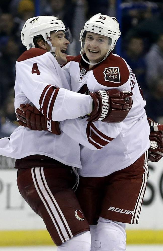 Phoenix Coyotes' Oliver Ekman-Larsson, right, of Sweden, is congratulated by Zbynek Michalek, of Czech Republic, after scoring the game-winning goal during overtime of an NHL hockey game against the St. Louis Blues Tuesday, Nov. 12, 2013, in St. Louis. The Coyotes won 3-2