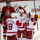 Ottawa Senators defenseman Jared Cowen looks on as Detroit Red Wings left wing Drew Miller celebrates his goal with teammates Joakim Andersson, left, and Tomas Tatar, right, during second period NHL hockey action Sunday Dec. 1, 2013 in Ottawa, Ontario The