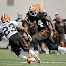 Cleveland Browns running back Ben Tate (44) runs the ball against cornerback Joe Haden (23) during team drills at the NFL football team's training camp in Berea, Ohio, Sunday, July 27, 2014 The Associated Press