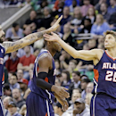 Atlanta Hawks' Pero Antic (6) high-fives Kyle Korver (26) in the fourth quarter during an NBA basketball game Monday, March 10, 2014, in Salt Lake City. The Hawks won 112-110 The Associated Press
