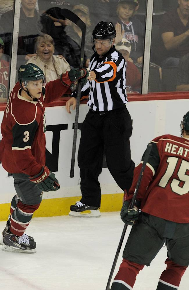Minnesota Wild's Charlie Coyle (3) celebrates as referee Dan O'Rourke, center, signals Coyle's goal against the Winnigeg Jets in the first period of an NHL hockey game on Saturday, Sept. 21, 2013, in St. Paul, Minn. Wild's Dany Heatley (15) joins the celebration