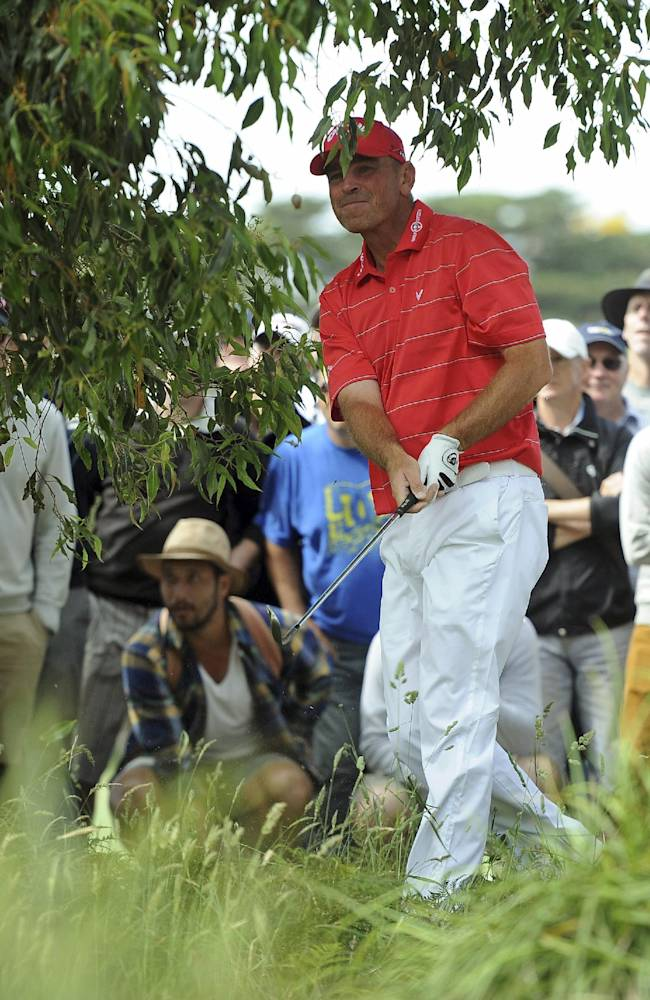 Thomas Bjorn of Denmark eyes his ball after hitting out of trees on the 17th hole during the final round of the World Cup of Golf at Royal Melbourne Golf Course in Australia, Sunday, Nov. 24, 2013