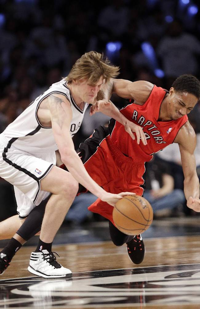 Brooklyn Nets' Andrei Kirilenko, of Russia, and Toronto Raptors' DeMar DeRozan, right, fight for control of the ball during the second half of Game 6 of the opening-round NBA basketball playoff series Friday, May 2, 2014, in New York. The Nets won the game 97-83