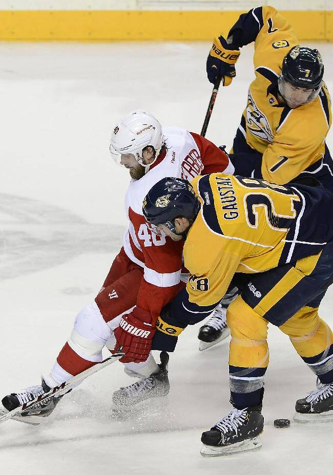 Detroit Red Wings center Henrik Zetterberg (40), of Sweden, Nashville Predators forward Paul Gaustad (28) forward Matt Cullen (7) battle for the puck in the third period of an NHL hockey game on Monday, Dec. 30, 2013, in Nashville, Tenn. The Predators won 6-4