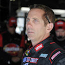 FILE - In this May 21, 2015, file photo driver Greg Biffle looks out of the garage before practice for the NASCAR Coca-Cola 600 Sprint Cup series auto race at Charlotte Motor Speedway in Concord, N.C. Biffle is confident Roush Fenway Racing is improving after a couple of down years trying to catch up to its rivals. Biffle had a strong two weeks at Charlotte Motor Speedway, capped by a second place in the Coca-Cola 600, his best on track showing this season. (AP Photo/Mike McCarn, File)