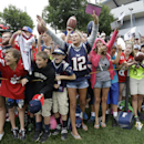New England Patriots NFL football fans cheer for members of the team while seeking autographs following a training camp practice at Gillette Stadium, Thursday, July 24, 2014, in Foxborough, Mass. (AP Photo) The Associated Press