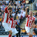 Stoke City's Ryan Shawcross, right, celebrates after he scored his teams first goal against Hull City, during their English Premier League match at the KC Stadium, Hull, England, Sunday Aug, 24, 2014