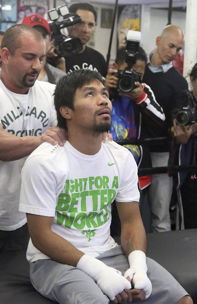 Manny Pacquiao receives a brief massage from Steve Fernandez on Wednesday April 2, 2014, in Los Angeles. Pacquiao is scheduled to fight Timothy Bradley April 12 in a WBO welterweight title bout