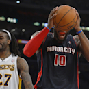 Detroit Pistons forward Greg Monroe, right, reacts after missing a shot as Los Angeles Lakers center Jordan Hill stands by during the second half of an NBA basketball game Sunday, Nov. 17, 2013, in Los Angeles The Associated Press