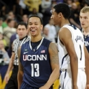 Connecticut guard Shabazz Napier celebrates his team's 65-58 victory over Notre Dame in an NCAA college basketball game, Saturday, Jan. 12, 2013, in South Bend, Ind. Napier lead all scorers with 19 points. (AP Photo/Joe Raymond)