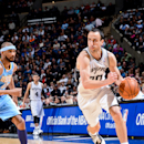 SAN ANTONIO, TX - MARCH 27: Manu Ginobili #20 of the San Antonio Spurs drives against Corey Brewer #13 of the Denver Nuggets on March 27, 2013 at the AT&T Center in San Antonio, Texas