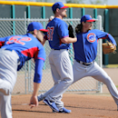 Chicago Cubs pitcher Jeff Samardzija, right, Travis Wood (37) and Justin Grimm throw during the team's first spring training baseball practice, Friday, Feb. 14, 2014, in Mesa, Ariz The Associated Press