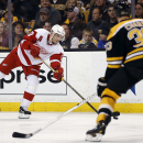 Detroit Red Wings' Pavel Datsyuk lets go a shot as Boston Bruins defenseman Zdeno Chara (33) defends during the third period of Detroit's 1-0 win in Game 1 of a first-round NHL playoff hockey series, in Boston on Friday, April 18, 2014 The Associated Pres