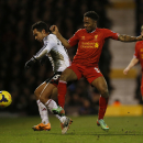 Fulham's Kieran Richardson, left, competes for the ball with Liverpool's Raheem Sterling during their English Premier League soccer match at Craven Cottage, London, Wednesday, Feb. 12, 2014