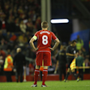 Liverpool's Steven Gerrard stands on the field at half time in the Champions League group B soccer match between Liverpool and Real Madrid at Anfield Stadium, Liverpool, England, Wednesday Oct. 22, 2014